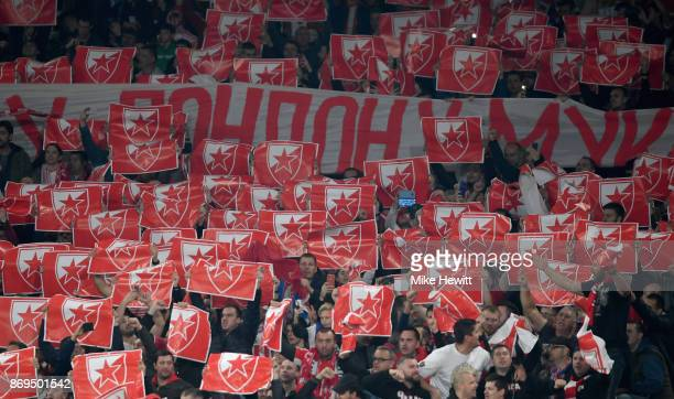 The FK Crvena Zvezda fans hold up banners during the UEFA Europa League group H match between Arsenal FC and Crvena Zvezda at Emirates Stadium on...