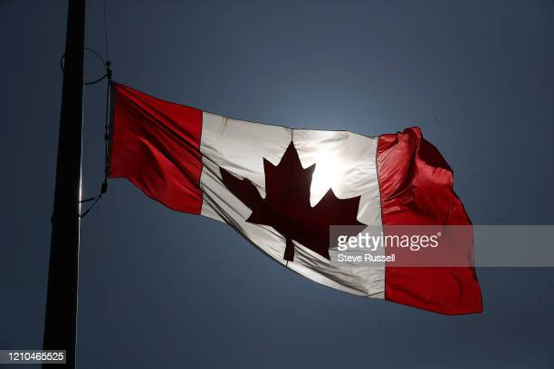 TORONTO ON APRIL 20 The flag at City Hall in Toronto flies at half mast in honour of the victims of the mass shooting in Nova Scotia April 20 2020
