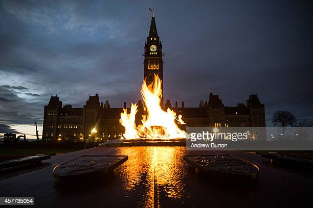 The flag atop the Canadian Parliament building is flown at halfstaff one day after Cpl Nathan Cirillo of the Canadian Army Reserves was killed while...