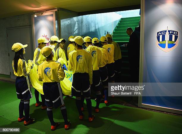 The flag bearers wait to enter the field the FIFA Club World Cup Playoff match for the quarter final between Sanfrecce Hiroshima and Auckland City FC...