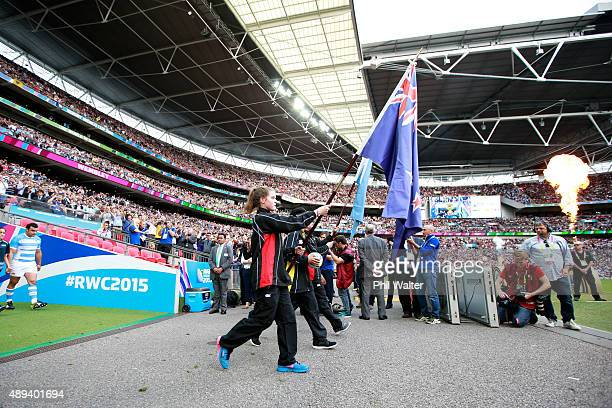The flag bearers walk out before the 2015 Rugby World Cup Pool C match between New Zealand and Argentina at Wembley Stadium on September 20 2015 in...