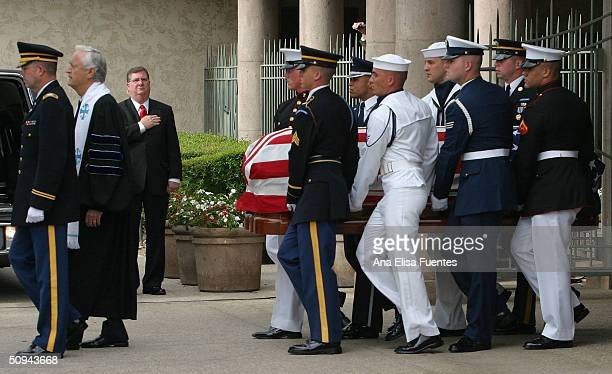 The flag draped casket of former president Ronald Reagan is carried to the hearse for transport to the Naval Base Ventura County at Point Mugu at the...
