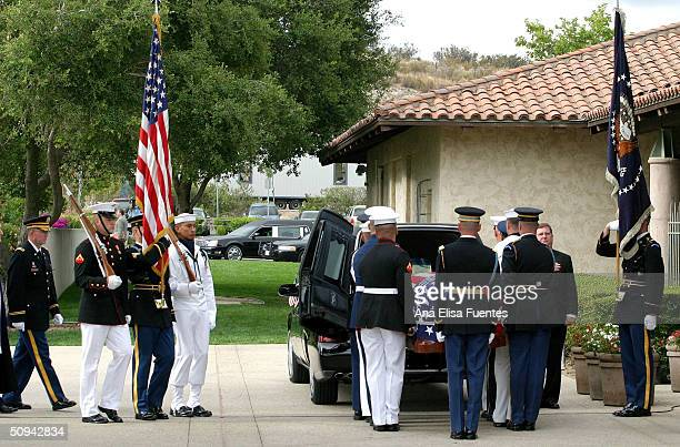 The flag draped casket of former President Ronald Reagan is placed into an awaiting hearse for transport to the Pt Mugu Naval Air Base at the Ronald...