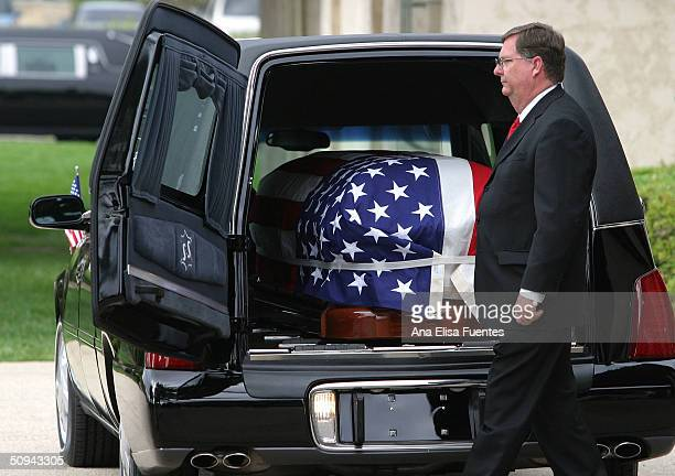 The flag draped casket of former President Ronald Reagan is placed into the hearse for transport to the Pt Mugu Naval Air Station at the Ronald...