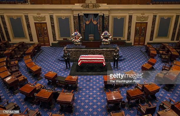 The flag draped casket of the late Senator Frank Lautenberg lies in repose in the chamber of the United States Senate on June 2013 in Washington DC