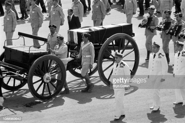 The flag draped coffin containing the body of assassinated Egyptian president Anwar Sadat is carried on a horsedrawn carriage and past the site of...