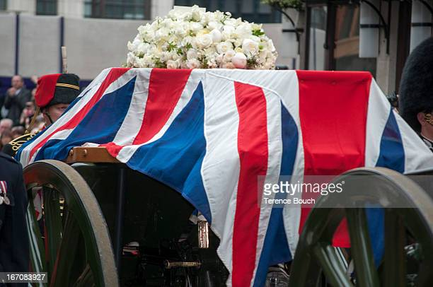 The flag draped coffin of Lady Thatcher is escorted through the streets of London by members of the armed forces as its makes it's way slowly to St...