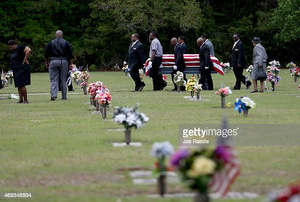 The flag drapped coffin of Walter Scott is carried by pallbearers to his burial site at the Live Oak Memorial gardens cemetery after he was fatally...