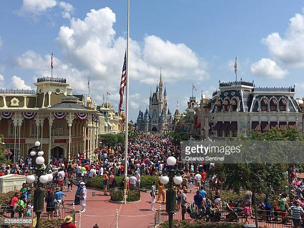 The flag is lowered to halfstaff on Monday June 13 2016 in Walt Disney World's Magic Kingdom in honor of the victims who died in the Pulse nightclub...