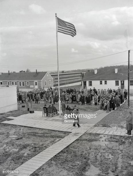 The flag is raised at the Housing project at Silver Spring Maryland Wilson W Wyatt the President's newly appointed Housing expeditor and John B...