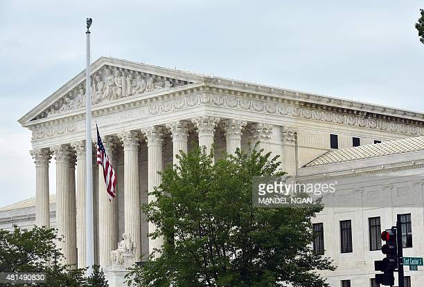 The flag is seen in front of the US Supreme Court as it flies at half staff on July 21 2015 in Washington DC US President Barack Obama ordered all...