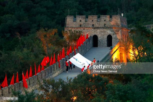 The flag of Beijing 2022 Winter Olympic Games is shown on the Badaling Great Wall during cultural activities to welcome the Beijing 2022 Olympic...