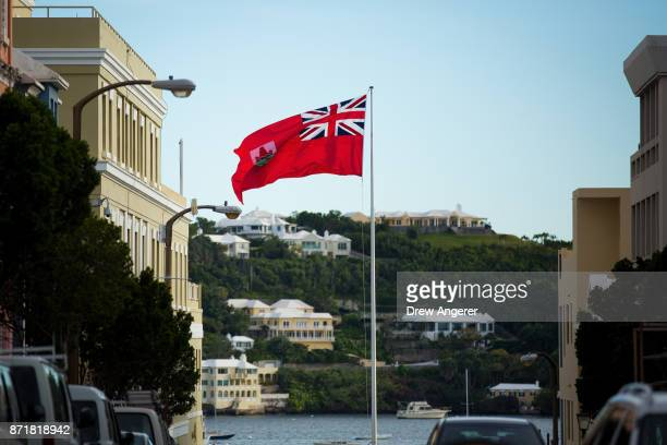 The flag of Bermuda flies as houses dot the hillside across Hamilton Harbour November 8 2017 in Hamilton Bermuda In a series of leaks made public by...
