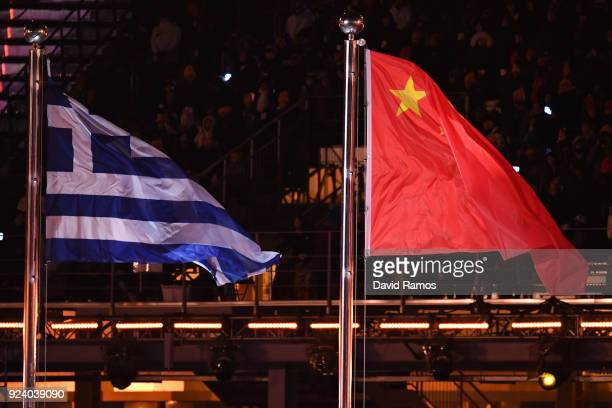The flag of China is raised next to the flag of Greece during the Closing Ceremony of the PyeongChang 2018 Winter Olympic Games at PyeongChang...