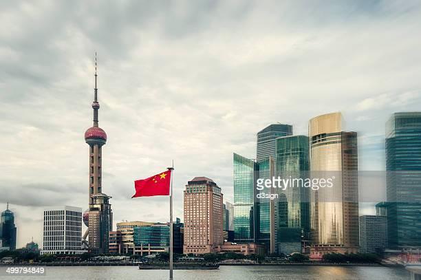 The flag of China waving along Pudong Shanghai
