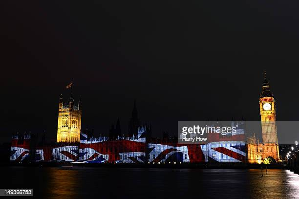 The flag of Great Britain is projected onto the House of Parliament and Big Ben during a light show to mark the start of the 2012 Olympic Games on...