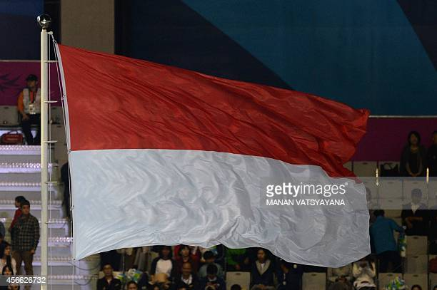 The flag of Indonesia the hosts of the 18th Asian Games in 2018 flies during the closing ceremony of the 2014 Asian Games at The Incheon Asiad Main...