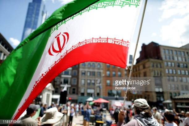 The flag of Iran is waved at a protest rally near Park Street Station in Boston on June 22 2019 A coalition of groups objected to US policy towards...