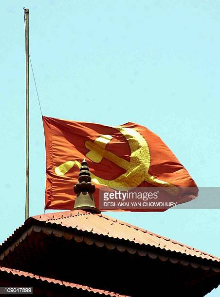 The flag of Nepal's Communist Party flies at halfmast at the party headquarters 06 June 2001 following the death 01 June of nine members of the...