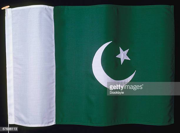 the flag of pakistan - pakistani flag stock photos and pictures