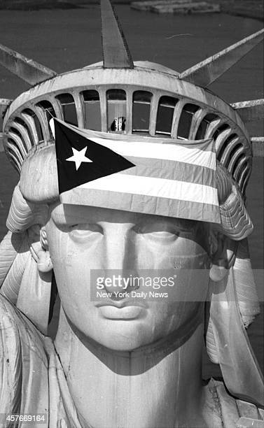 The flag of Puerto Rico flies from the head of the Statue of Liberty after 28 Puerto Rican nationals seized the Liberty Island and the statue this...