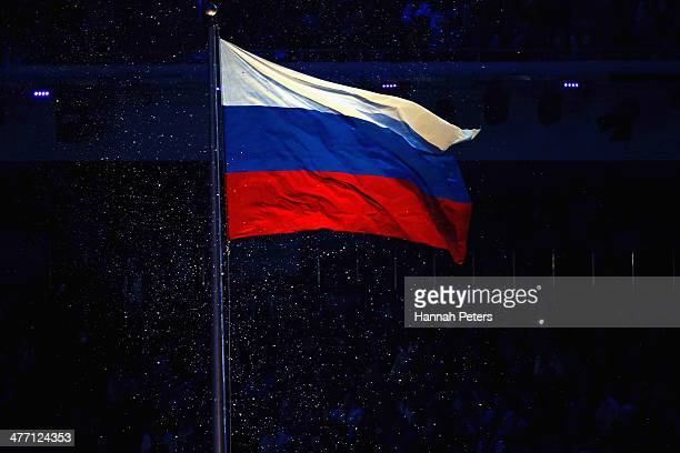 The flag of Russia is raised during the Opening Ceremony of the Sochi 2014 Paralympic Winter Games at Fisht Olympic Stadium on March 7 2014 in Sochi...