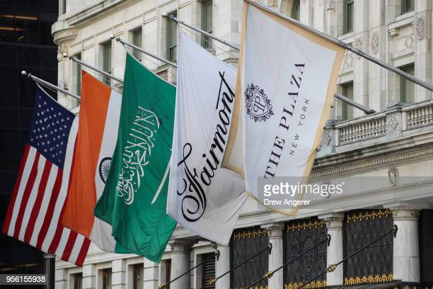 The flag of Saudi Arabia hangs alongside flags for the Plaza Hotel at the entrance to the Plaza Hotel in Midtown Manhattan May 8 2018 in New York...