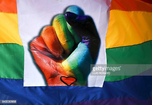 The flag of sexual diversity is seen during the Gay Pride Parade in Cali Colombia on June 26 2016 / AFP / LUIS ROBAYO