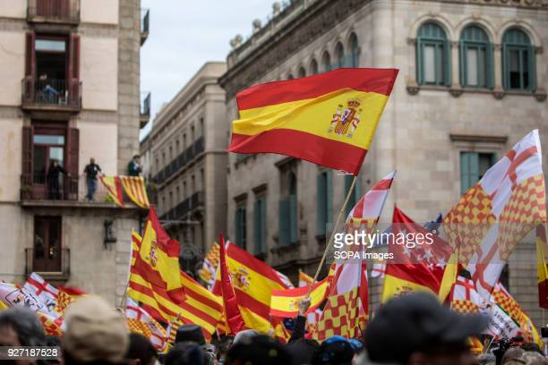 The flag of spain seen being displayed during the rally Thousands of people have taken to the streets of Barcelona to demonstrate and show their...