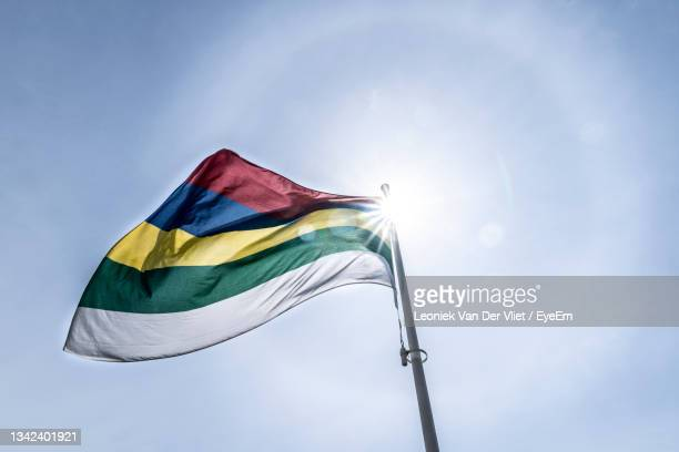 the flag of terschelling wadden island the netherlands  with sun and a sun haloan optical phenomenon - light natural phenomenon stock pictures, royalty-free photos & images