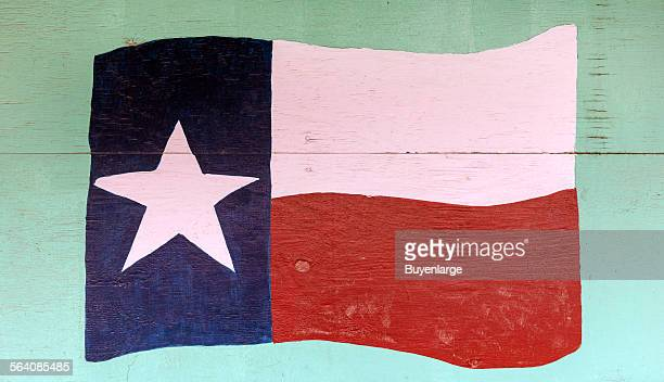 The flag of Texas depicted on a downtown wall in Pecos the seat of Reeves County Texas
