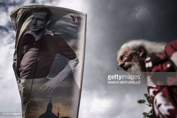 The flag of the captain of Grande Torino Valentino Mazzola is seen during the tribute to the Grande Torino football team at the monument dedicated to...