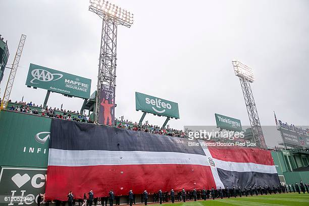The flag of the Dominican Republic is dropped over the Green Monster during an honorary retirement ceremony for David Ortiz of the Boston Red Sox in...