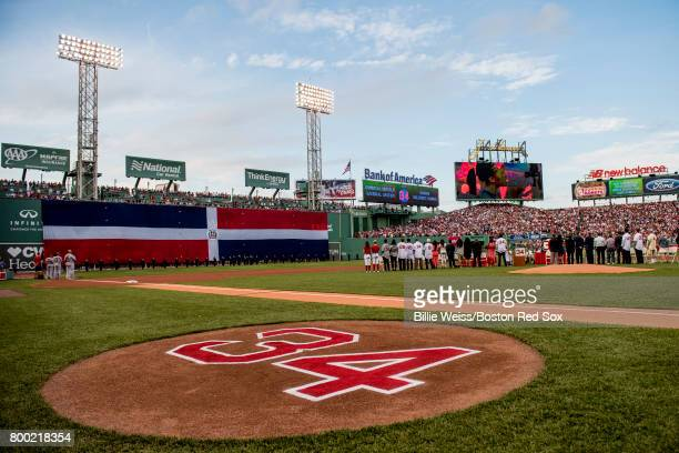 The flag of the Dominican Republic is dropped over the Green Monster during a ceremony for the retirement of the jersey number of David Ortiz before...