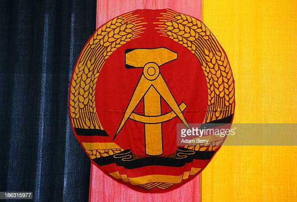 The flag of the German Democratic Republic hangs at the Stasi or East German Secret Police Museum on October 30 2013 in Berlin Germany German...