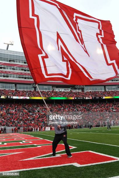 The flag of the Nebraska Cornhuskers is waved after a score during the Spring game at Memorial Stadium on April 21 2018 in Lincoln Nebraska