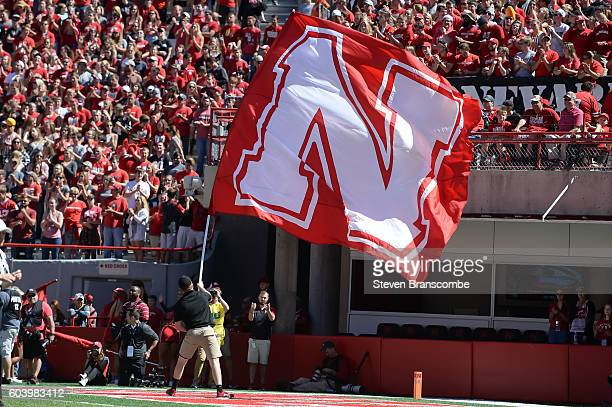 The flag of the Nebraska Cornhuskers waves after a score against the Wyoming Cowboys at Memorial Stadium on September 10 2016 in Lincoln Nebraska...