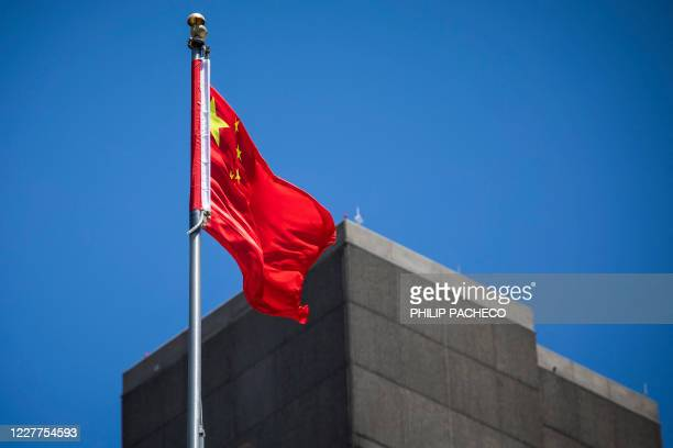 The flag of the People's Republic of China flies in the wind above the Consulate General of the People's Republic of China in San Francisco,...