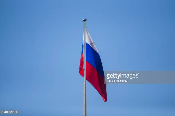 The flag of the Russian Federation flies above the Russian Embassy March 31 2018 in Washington DC First group of expelled Russian diplomats leaves on...