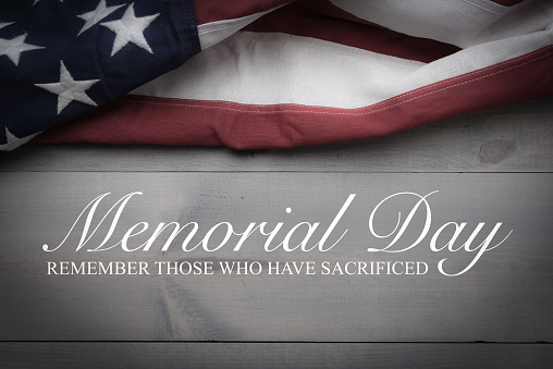 The flag of the United Sates on a grey plank background with memorial day 956259298