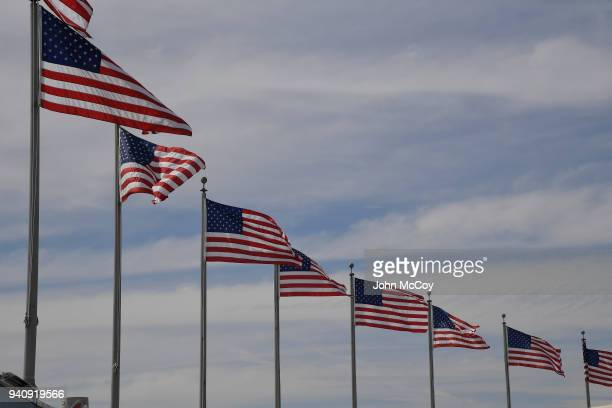 The flag of the United States of America flies over the entrance at the top of the park at Dodgers Stadium The Los Angeles Dodgers defeated the San...