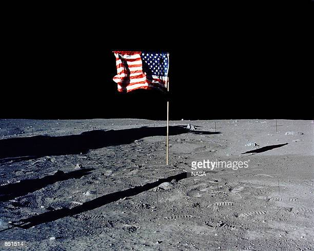 The flag of the United States stands alone on the surface of the moon. The 30th anniversary of the Apollo 11 Moon landing mission is celebrated July...