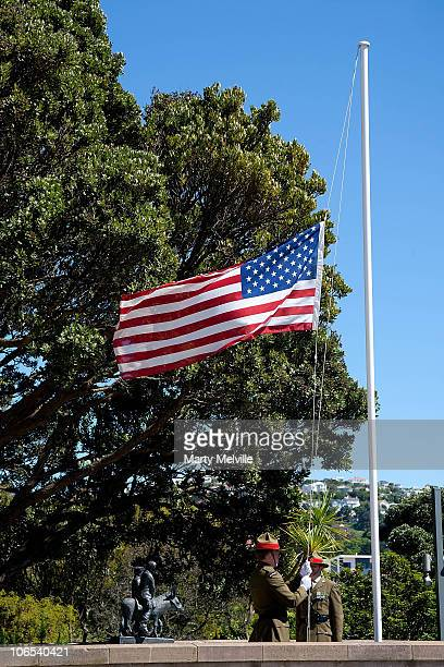The flag of the Unites States of America is flown at half mast during the sounding of the Last Post as United States Secretary of State Hillary...
