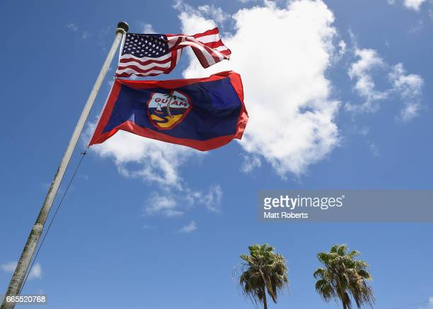 The flag of the USA and Guam are seen during the SMS Cormoran II 100 Years Memorial Ceremony at US Agana Navy Cemetery on April 7 2017 in Guam Guam...