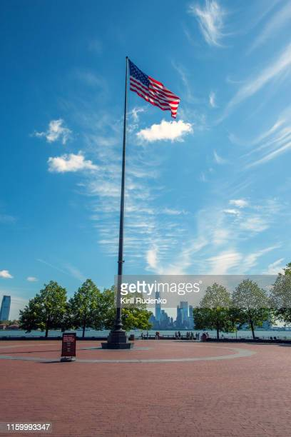 the flag of the usa on a pole, liberty island, new york city, usa - flagpole stock pictures, royalty-free photos & images