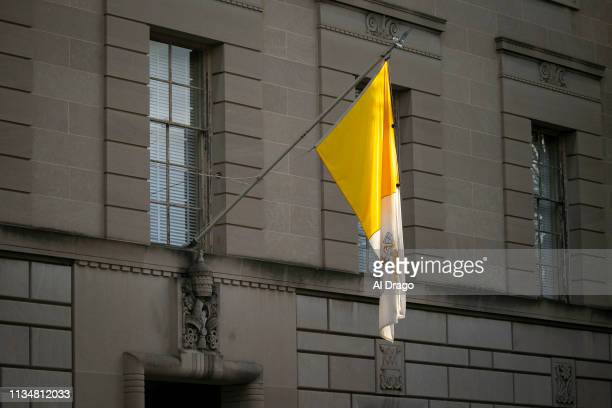 The flag of Vatican City hangs at the Apostolic Nunciature of the Holy See on April 4 2019 in Washington DC Pope Francis has named the Archbishop of...
