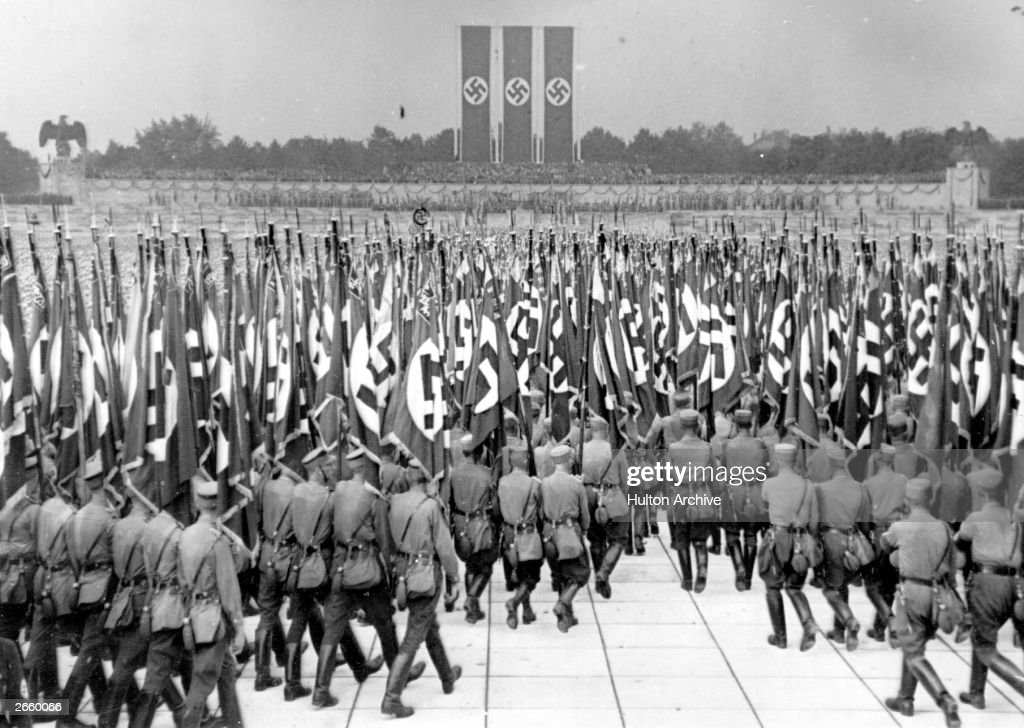 The flag parade of Hitler's militia (SS and SA) at a Nazi Rally in the Luitpold Stadium at Nuremberg.