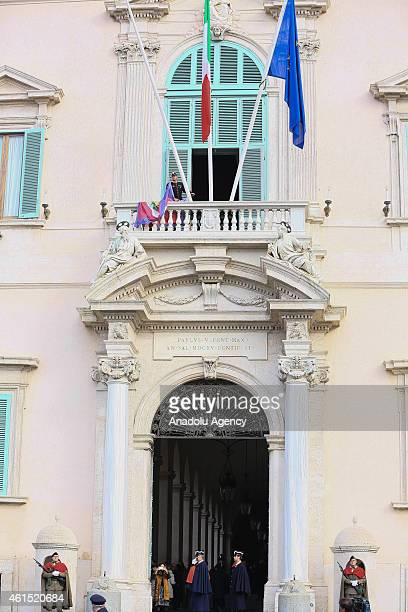 The flag represents presidency is lowered following Italy's President Giorgio Napolitano leaves the Quirinal Presidential Palace in Rome Italy on...
