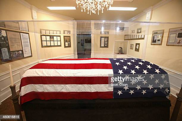 The flag that was draped over the casket of President John F. Kennedy as his body lay in state in the East Room of the White House is displayed at...