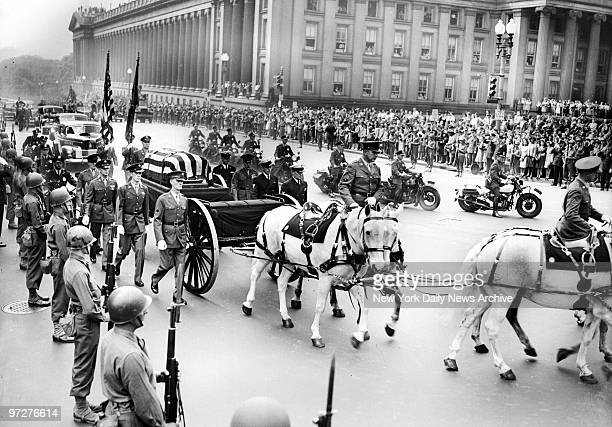 The flagdraped casket and the horsedrawn caisson moving slowly along New York Avenue NW to 15th Street during Franklin D Roosevelt funeral procession